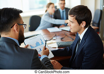 Business discussion - Businessman with document explaining...