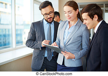 Woman showing document - Confident businesswoman with...
