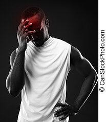 Frustrated african man over black background