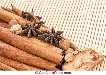Various spices on bamboo stick tied with a rope background