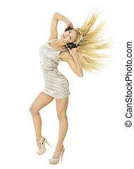Woman in headpnones dancing listening to music. Girl portrait