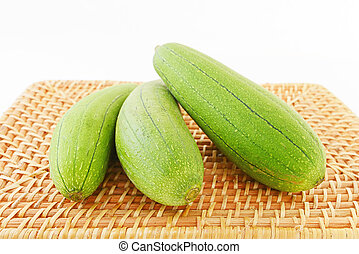 Fresh vegetables - Long loofah on white background