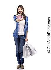 Woman with money and shopping bags - Beauitful woman holding...