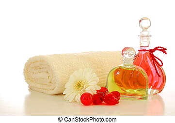 massage oil - bottle with massage oil isolated on white...