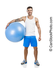 Athletic man with a pillates ball - Athletic young man...