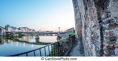 Walls of Pisa along Arno river.
