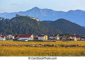 Rasnov fortress and Bucegi mountains, Romania - Autumn...