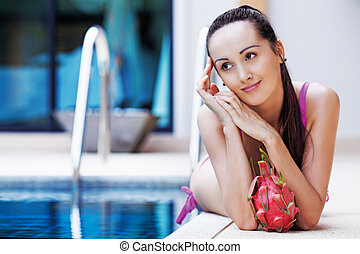 woman by the swimming pool