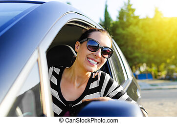 Car driver happy - Woman drives a car on the road and...