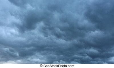 Stormy clouds moving in the dark sky