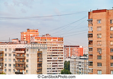 residential buildings in city block at sunset