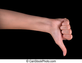 Disapproval - thumbs down hand sign isolated on black...