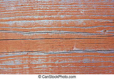 Texture of wall of rusty-red color boards with flaky paint