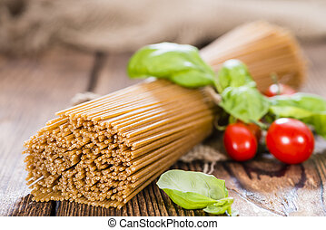 Wholemeal Spaghetti close-up shot on an old wooden table