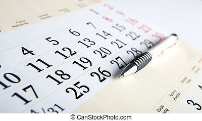 calendar days with numbers and pen close up