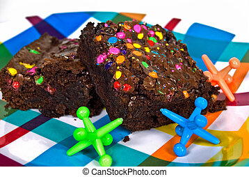 Funfetti Brownies - Colorful candies on brownies with toy...