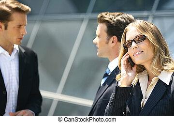 business people near modern building