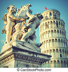 Statue of angels and Leaning Tower - Statue of angels on...