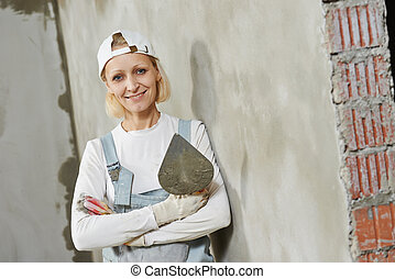 Female plasterer portrait - Portrait of plasterer at indoor...