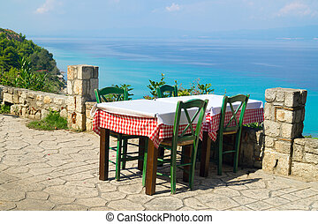 Traditional Greek table at the beach in Greece