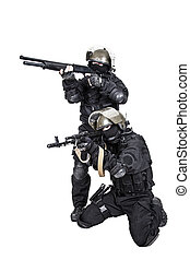 spec ops in action - Two spec ops soldiers in black uniform...