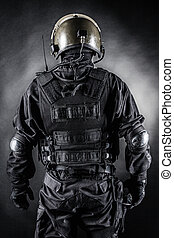 Spec ops soldier on black background shot from behind