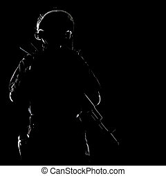 spec ops - Contour shot of spec ops soldier on black...