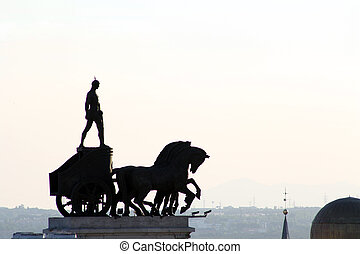 Chariot Sculpture on top of a Bank Building in Alcala Street...