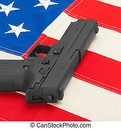 Handgun laying over USA flag - studio shoot - 1 to 1 ratio