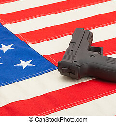 Handgun over USA flag - studio shoot - 1 to 1 ratio