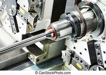 metal turning process on machine tool - shaft detail turning...