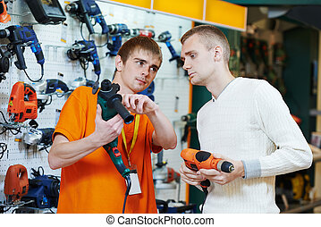 shopping at electric appliance supermarket - Sale assistant...