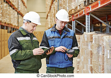 warehouse crew at work - workers in warehouse with bar code...
