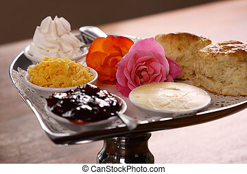 Delicious butter scones on a silver heart shaped tray served...