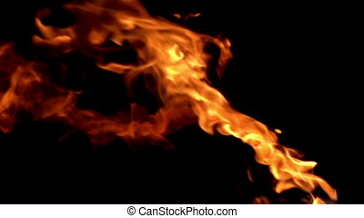 Flames on a Black Background - Fire ignites a stream of...