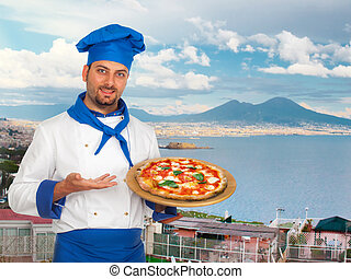 Young chef with neapolitan pizza margherita with Gulf of...