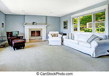 Light blue living room with white sofa and fireplace