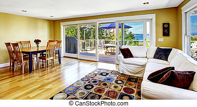 Living room with walkout deck and bay view. Tacoma real...