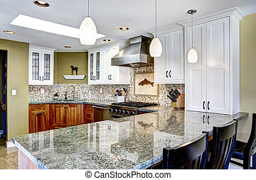 Modern house interior. Kitchen room with shiny granite tops...