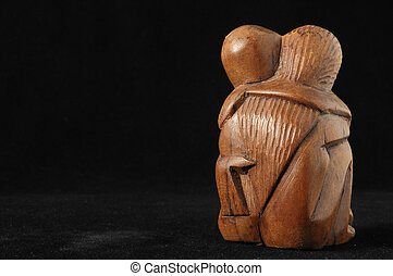 Lovers Sculpture made of Wood on a Black Background