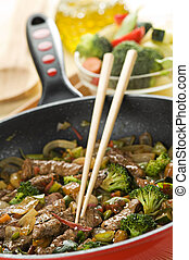 Wok - Beef and vegetables in wok close up shoot