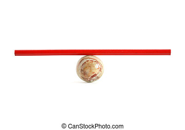 Balance Concept - Red pencil on ball made from semiprecious...