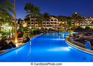 Swimming pool at night - vacation background