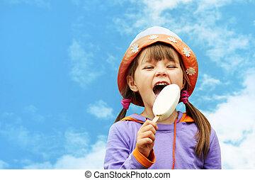 girl eating ice cream - little girl in hat eating ice cream...