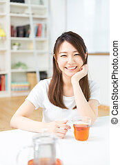 woman who drink tea - young attractive asian woman who drink...