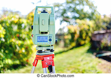 surveying equipment with transit total station and...