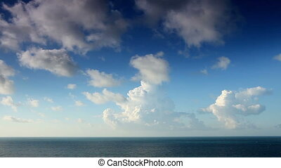 Cloudy sky over the sea. Time Lapse