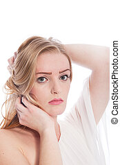 Blond Woman with Hands in Hair on White Background