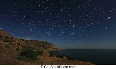 Time lapse of stars behind mountain - Night landscape, night...