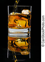 glass of whiskey - Photo of a glass of whiskey and ice on a...